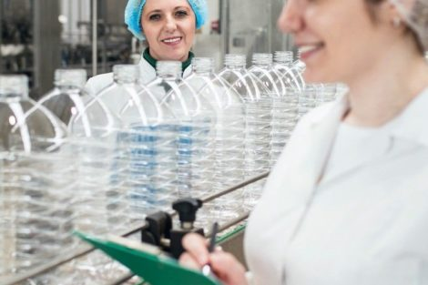 Female_workers_in_bottling_factory_checking_water_bottles_before_shipment._Inspection_quality_control._