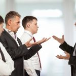 Business_conflict_concept._Four_businessman_are_trying_to_come_to_an_agreement