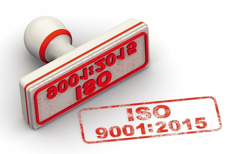 "Red_seal_and_imprint_""ISO_9001:2015""_on_white_surface"