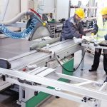 CNC_machine_shop_with_lathes,_technicians_and_workers